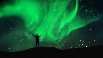 Northern lights aurora borealis in the night sky